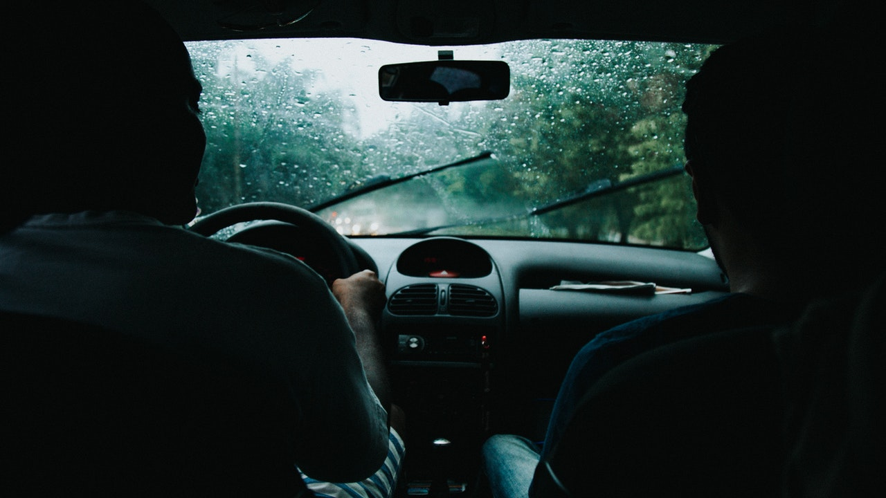 two-men-inside-moving-vehicle-799463